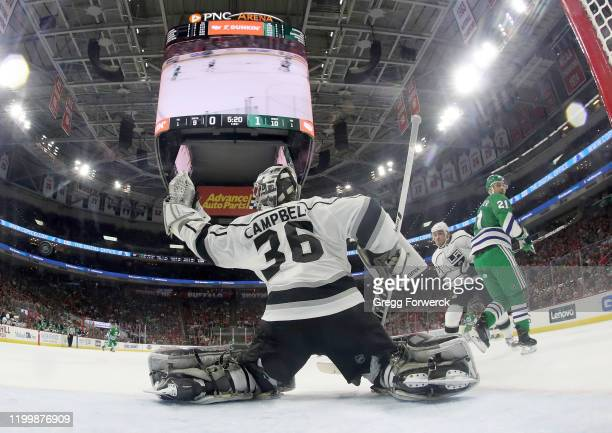 Jack Campbell of the Los Angeles Kings makes a glove save in the crease during an NHL game against the Carolina Hurricanes on January 11 2020 at PNC...