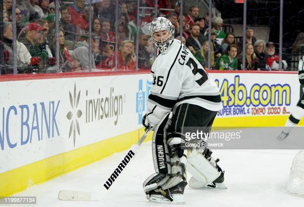 Jack Campbell of the Los Angeles Kings plays the puck behind the net during an NHL game against the Carolina Hurricanes on January 11 2020 at PNC...