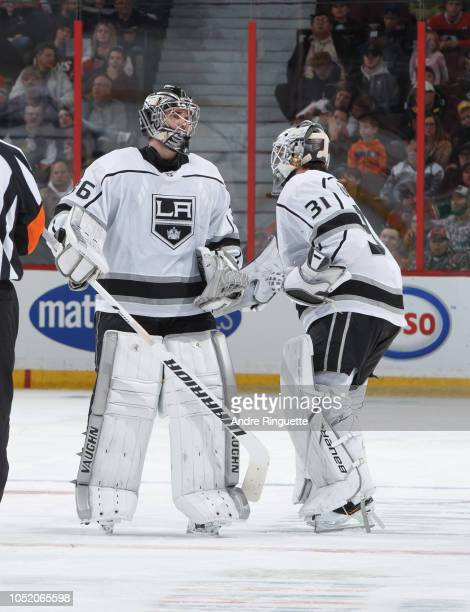 Jack Campbell of the Los Angeles Kings taps pads with teammate Peter Budaj after being pulled in the second period of a game against the Ottawa...