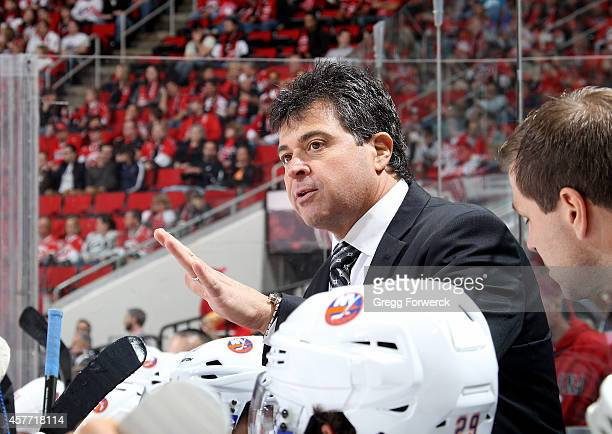 Jack Capuano head coach of the New York Islanders coaches players from the bench area during their NHL game against the Carolina Hurricanes at PNC...