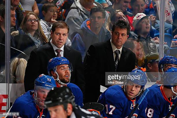 Jack Capuano of the New York Islanders and Assistant coach Doug Weight look on against the New Jersey Devils at Nassau Veterans Memorial Coliseum on...