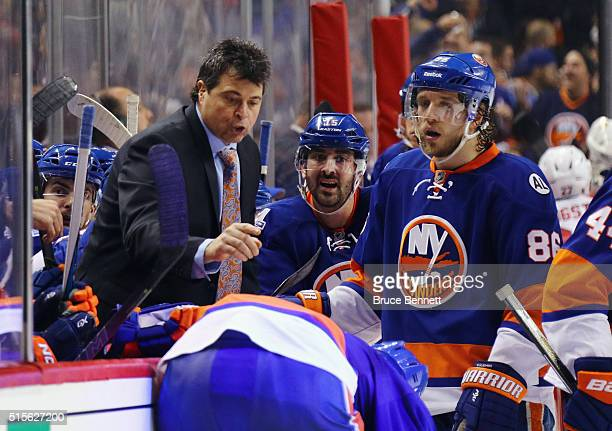 Jack Capuano of the New York Islanders gives players instructions in the final minutes of the game against the Florida Panthers at the Barclays...