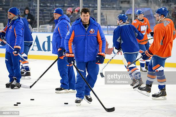 Jack Capuano of the New York Islanders looks on during the 2014 NHL Stadium Series practice session at Yankee Stadium on January 28 2014 in the Bronx...