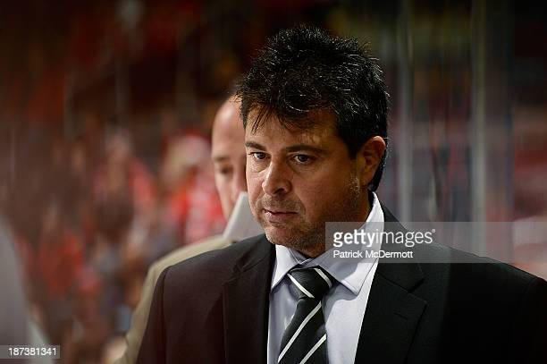 Jack Capuano of the New York Islanders looks on from the bench during an NHL game against the Washington Capitals at Verizon Center on November 5...