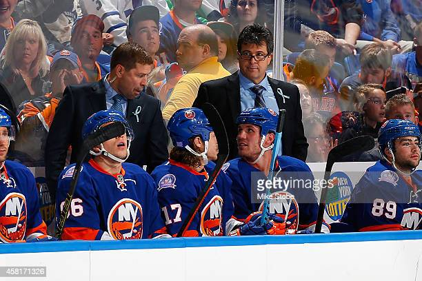 Jack Capuano of the New York Islanders looks on from the bench against the Toronto Maple Leafs at Nassau Veterans Memorial Coliseum on October 21...