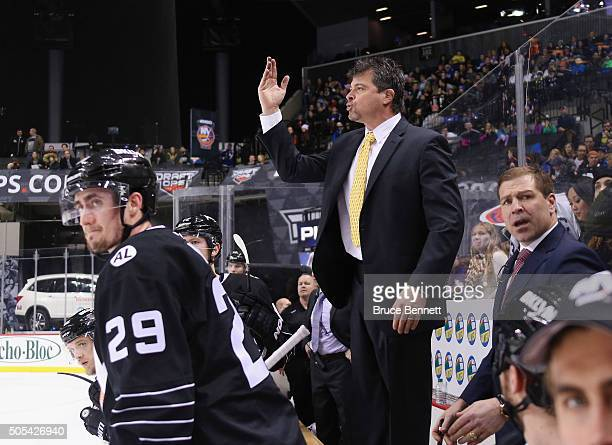 Jack Capuano of the New York Islanders signals the referee during the third period against the Vancouver Canucks at the Barclays Center on January 17...