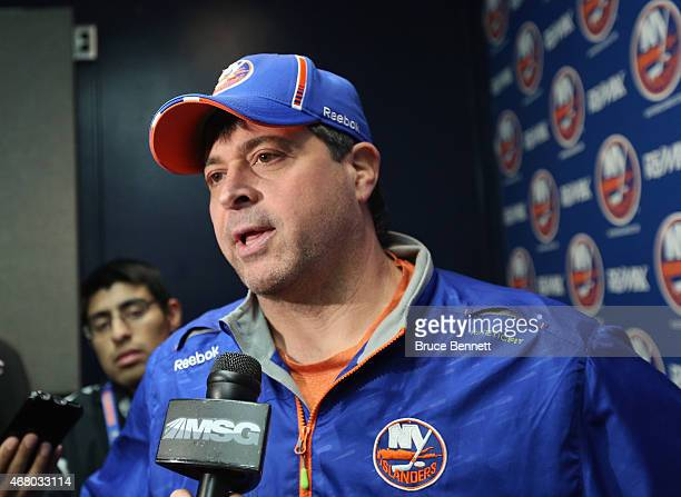 Jack Capuano of the New York Islanders speaks with the media prior to the game against the Detroit Red Wings at the Nassau Veterans Memorial Coliseum...
