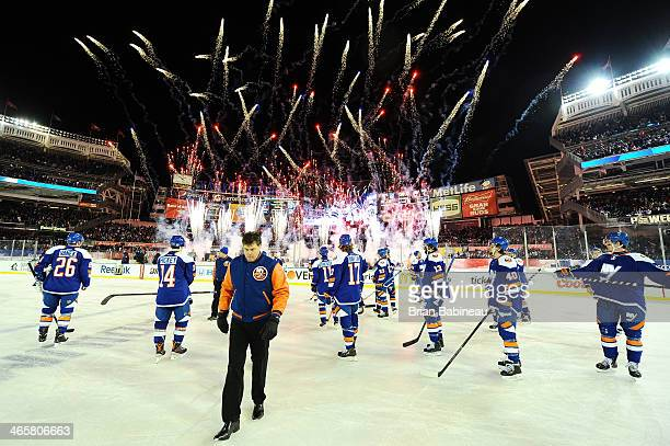 Jack Capuano of the New York Islanders walks off the ice following the 2014 Coors Light NHL Stadium Series against the New York Rangers at Yankee...