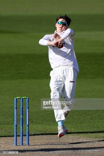 Jack Carson of Sussex bowls during the LV= Insurance County Championship match between Sussex and Lancashire at Emirates Old Trafford on April 09,...