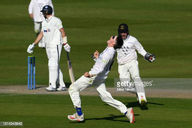 Jack Carson of Sussex celebrates after dismissing Joe Root of Yorkshire during day 2 of the LV= Insurance County Championship match between Sussex...