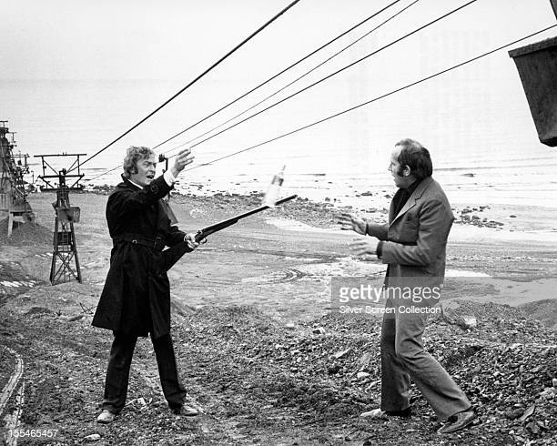Jack Carter, played by English actor Michael Caine, throws a bottle of whisky to Eric Paice, played by Ian Hendry , in the final scene of 'Get...