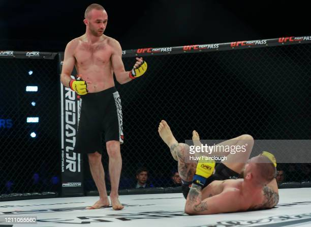 Jack Cartwright Beckons Manuel Bilic to stand during their Bantamweight Title during Cage Warriors 112 on March 7 2020 in Manchester England