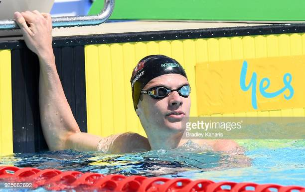Jack Cartwright checks his time after competing in the heats of the Men's 100m Freestyle event during the 2018 Australia Swimming National Trials at...