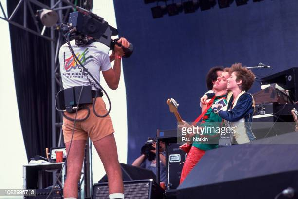Jack Charles and Rindy Ross of Quarterflash perform on stage at the US Festival as a cameraman shoots their performance in Ontario Canada May 30 1983