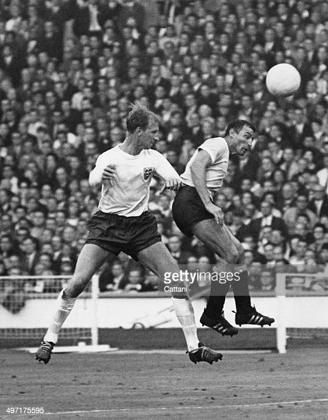 Jack Charlton challenges for the ball during the opening match of the 1966 World Cup at Wembley Stadium, England vs Uruguay, 11th July 1966. The...