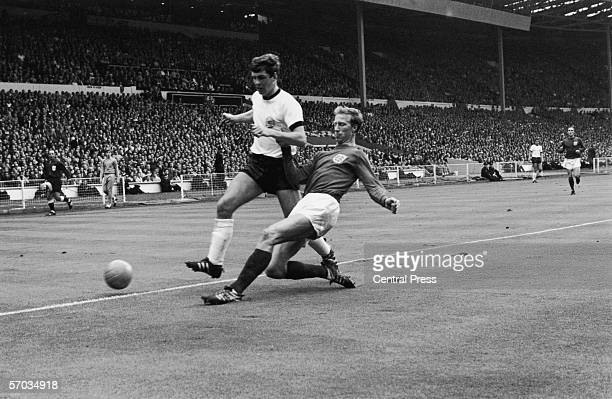 Jack Charlton tackles Wolfgang Weber for the ball during the 1966 World Cup final at Wembley Stadium, London, 30th July 1966.