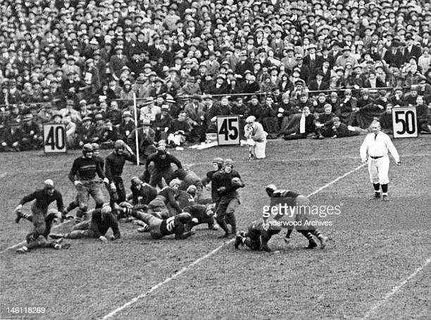 Jack Chevigny of Notre Dame gains five yards in the game against Army at Yankee Stadium, New York, New York, November 10, 1928. Earlier Knute Rockne...