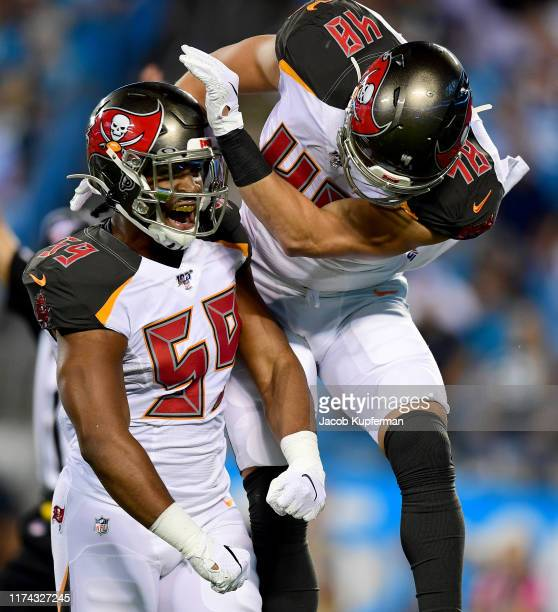 Jack Cichy of the Tampa Bay Buccaneers and Devante Bond of the Tampa Bay Buccaneers react after a tackle in the first quarter during their game...