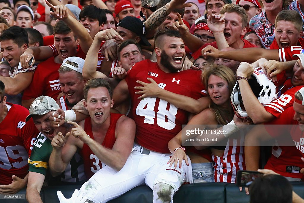 Jack Cichy #48 of the Wisconsin Badgers celebrates with fans after defeating the LSU Tigers 16-14 at Lambeau Field on September 3, 2016 in Green Bay, Wisconsin.