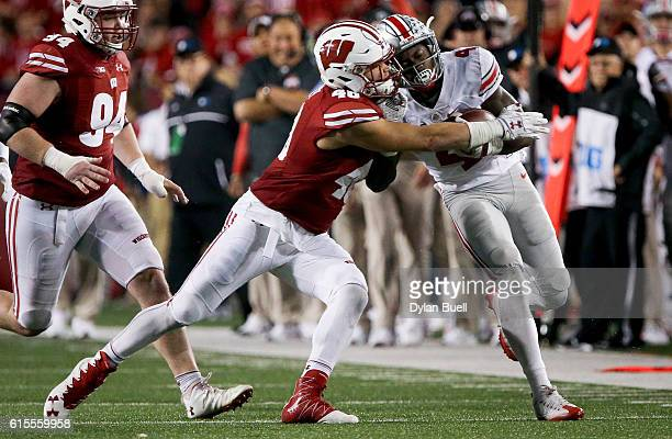 Jack Cichy of the Wisconsin Badgers tackles Curtis Samuel of the Ohio State Buckeyes in the fourth quarter at Camp Randall Stadium on October 15 2016...