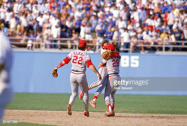 Jack Clark Ozzie Smith and Tommy Herr of the St Louis Cardinals celebrate after winning the National League Championship Series in game six against...