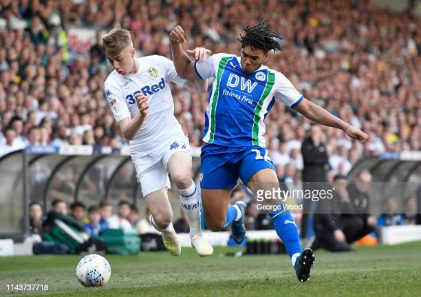 Jack Clarke of Leeds United and Reece James of Wigan Athletic compete for the ball during the Sky Bet Championship between Leeds United and Wigan...