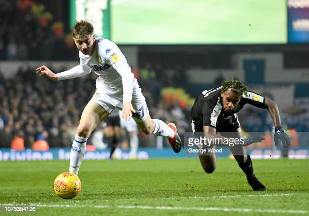Jack Clarke of Leeds United Leandro Bacuna of Reading compete for the ball during the Sky Bet Championship match between Leeds United and Reading at...