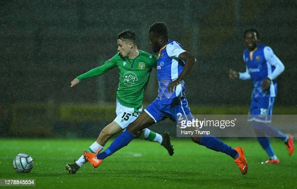 Jack Clarke of Yeovil Town is tackled by Michee Efete of Wealdstone during the Vanarama National League match between Yeovil Town and Wealdstone at...