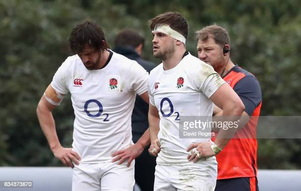 Jack Clifford looks on with Tom Wood who has been dropped to the replacement bench during the England training session held at Pennyhill Park on...