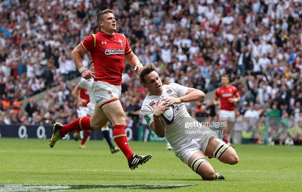 Jack Clifford of England breaks clear to score their fourth try during the England v Wales International match at Twickenham Stadium on May 29, 2016 in London, England.