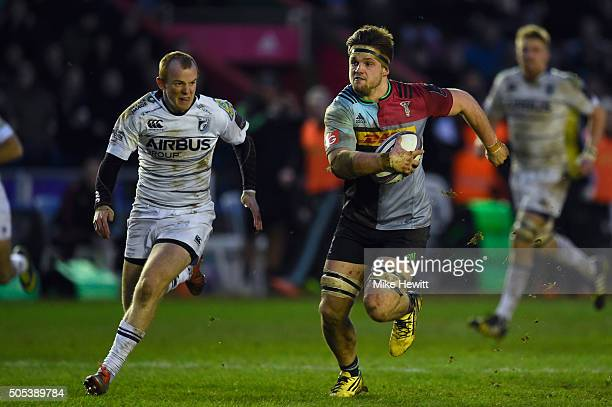 Jack Clifford of Harlequins is chased by Dan Fish of Cardiff during the European Rugby Challenge Cup match between Harlequins and Cardiff Blues at...