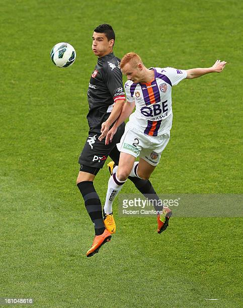 Jack Clisby of the Glory is challenged for the ball by Eli Babalj of the Heart during the round 20 A-League match between the Melbourne Heart and the...