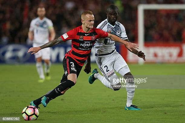 Jack Clisby of the Wanderers is challenged by Jason Geria of the Victory during the round 10 ALeague match between the Western Sydney Wanderers and...