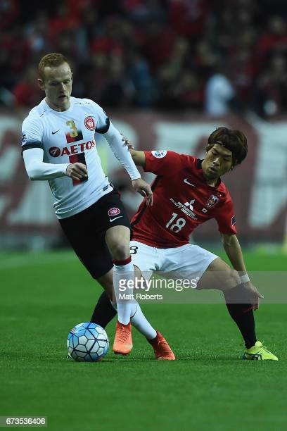 Jack Clisby of Western Sydney Wanderers competes for the ball against Yoshiaki Komai of Urawa Red Diamonds during the AFC Champions League Group F...