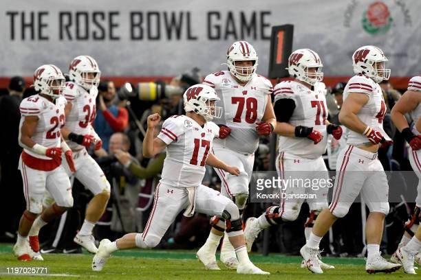 Jack Coan of the Wisconsin Badgers celebrates after Mason Stokke scored a one yard touchdown against the Oregon Ducks during the third quarter in the...