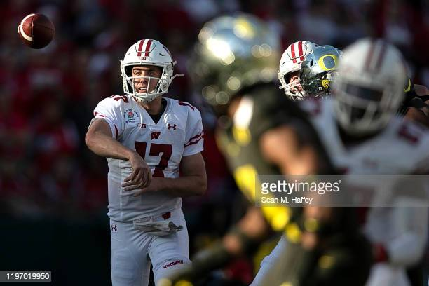 Jack Coan of the Wisconsin Badgers throws a pass against the Oregon Ducks during the first half in the Rose Bowl game presented by Northwestern...
