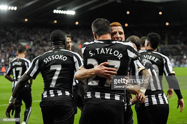 Jack Colback hugs Steven Taylor after Steven scores the opening goal during the Barclays Premier League match between Newcastle United and Burnley at...