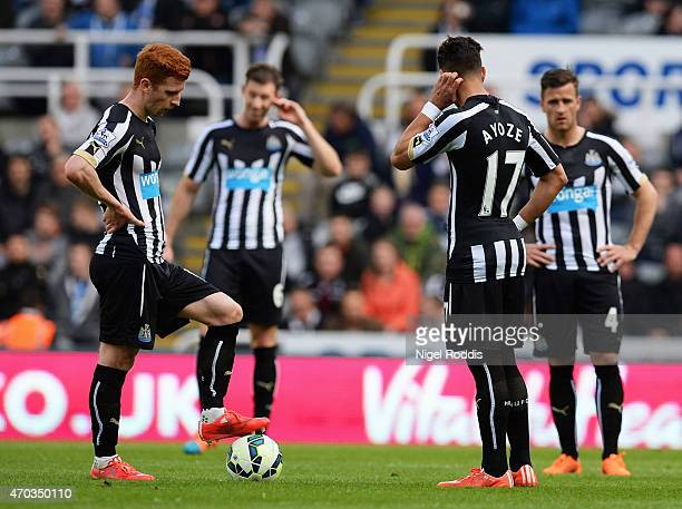 Jack Colback of Newcastle United and Ayoze Perez of Newcastle United prepare to restart after conceding the first goal during the Barclays Premier...