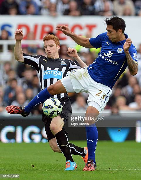 Jack Colback of Newcastle United and Leonardo Ulloa of Leicester City compete for the ball during the Barclays Premier League match between Newcastle...