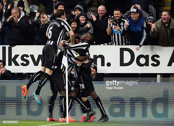 Jack Colback of Newcastle United celebrates with fans and team mates as he scores their first goal during the Barclays Premier League match between...