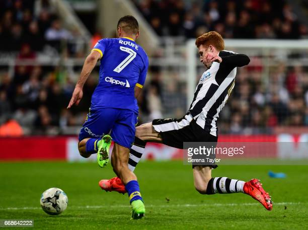 Jack Colback of Newcastle United makes a sliding tackle to win the ball from Kemar Roofe of Leeds United during the Sky Bet Championship Match...