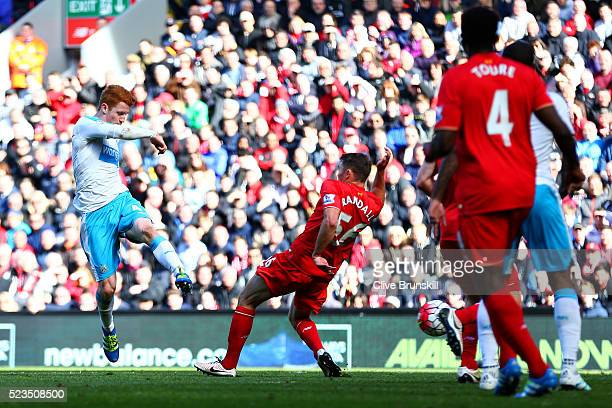 Jack Colback of Newcastle United scores his sides second goal during the Barclays Premier League match between Liverpool and Newcastle United at...