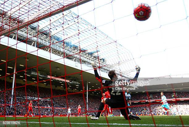 Jack Colback of Newcastle United scores past Simon Mignolet of Liverpool to equal the scoring during the Barclays Premier League match between...