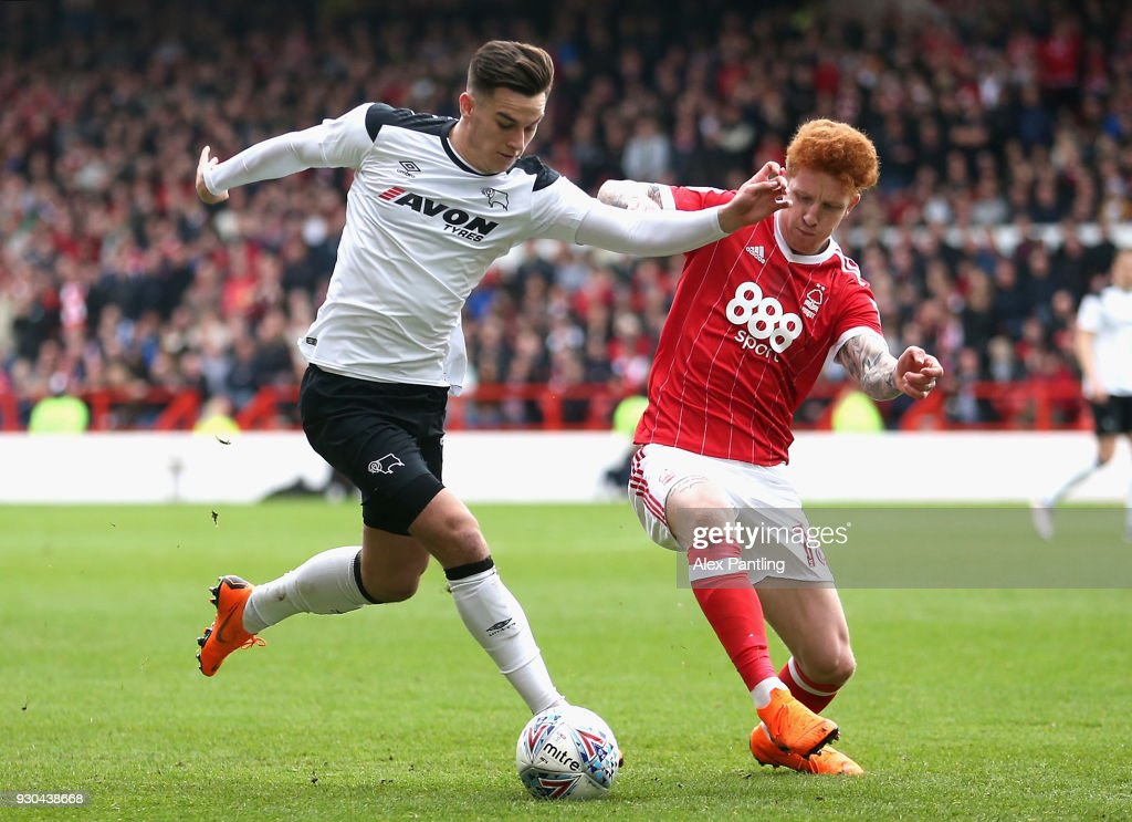 Jack Colback of Nottingham Forest and Tom Lawrence of Derby County in action during the Sky Bet Championship match between Nottingham Forest and Derby County at City Ground on March 11, 2018 in Nottingham, England.