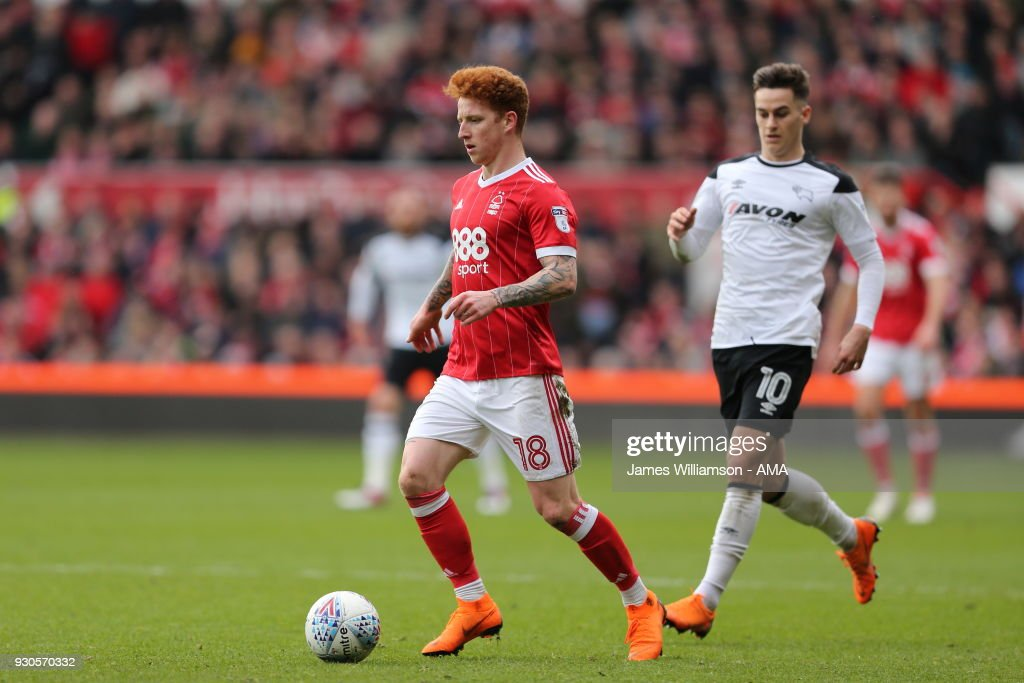 Jack Colback of Nottingham Forest and Tom Lawrence of Derby County during the Sky Bet Championship match between Nottingham Forest and Derby County at City Ground on March 11, 2018 in Nottingham, England.