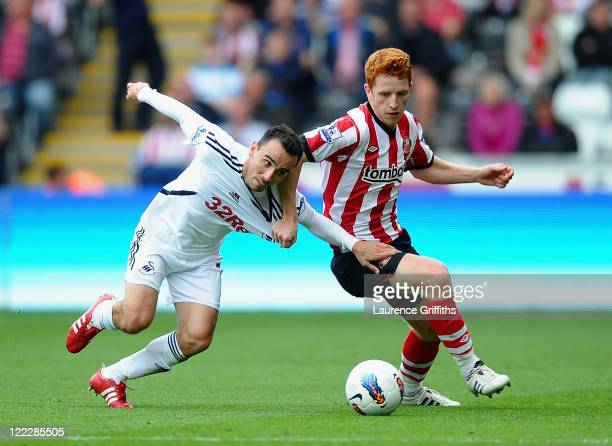 Jack Colback of Sunderland battles for the ball with Leon Britton of Swansea City during the Barclays Premier League match between Swansea City and...