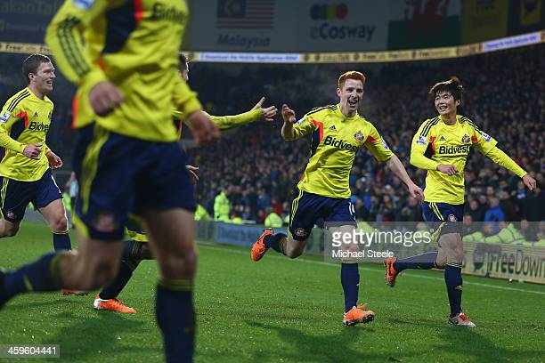 Jack Colback of Sunderland celebrates scoring the equalising goal during the Barclays Premier League match between Cardiff City and Sunderland at the...