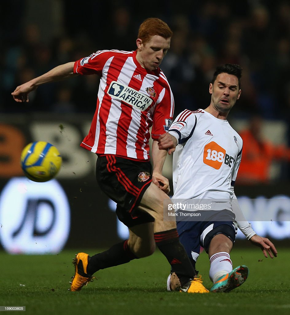 Jack Colback of Sunderland competes with Chris Eagles of Bolton Wanderers during the FA Cup with Budweiser Third Round match between Bolton Wanderers and Sunderland at the Reebok Stadium on January 5, 2013 in Bolton, England.