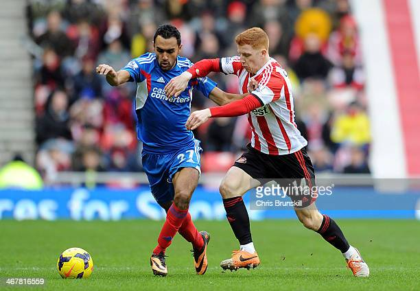 Jack Colback of Sunderland in action with Ahmed Elmohamady of Hull City during the Barclays Premier League match between Sunderland and Hull City at...