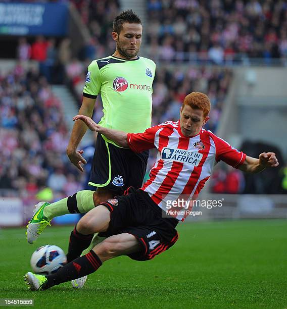 Jack Colback of Sunderland tackles Yohan Cabaye of Newcastle during the Barclays Premier League match between Sunderland and Newcastle United at the...